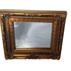 Gold thick framed mirror